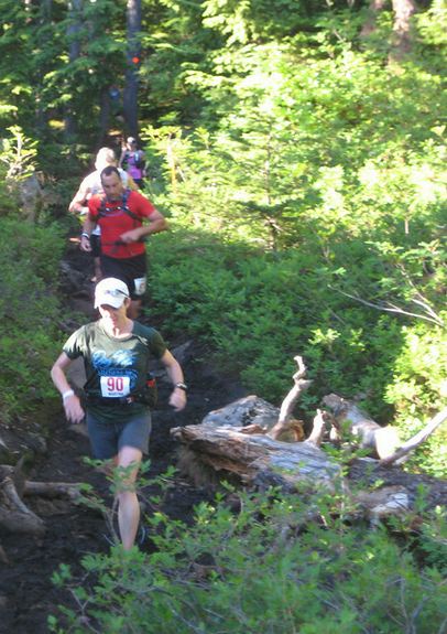 The congo line of runners heading down Black Mtn towards Cypress aid station. photo credit: Ivan