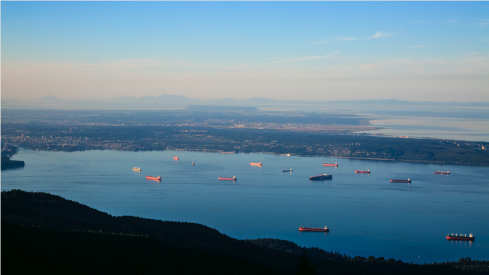A spectacular view of the freighters in English Bay, Point Grey, Richmond and Puget Sound beyond. photo credit: Herman Kwong