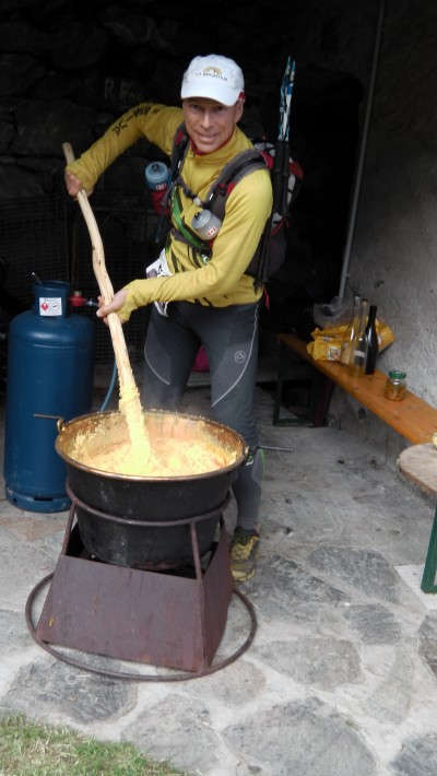 Using the offical polenta paddle, bruce stirs up a tasty brew - and earns us the tastiest morsel of meat we have ever savoured!