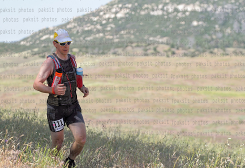 B flies along open grassland in the early stages of the course.